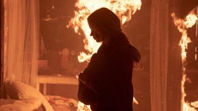 De familie Abbott leeft nog steeds in stilte in de spannende nieuwe trailer van 'A Quiet Place Part II'